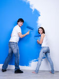 Happy couple near the painted wall Royalty Free Stock Photo