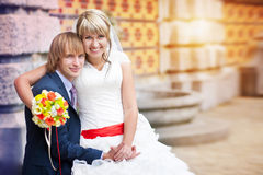 Happy couple near the patterned wall Stock Photo