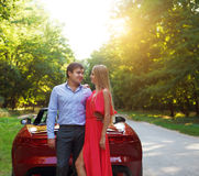 Happy couple near the red cabriolet Stock Photo