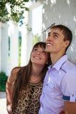 Happy couple near white architecture in a summer sunny park Stock Photo