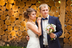 Happy couple near wooden logs Stock Photos