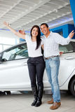 Happy couple with new car Royalty Free Stock Photography