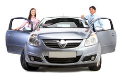 Happy couple with new car Stock Image