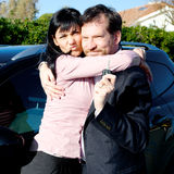 Happy couple with new car Stock Images