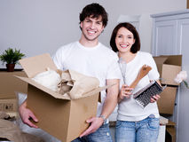 Happy couple in the new flat Stock Image