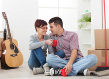 Happy couple in new house Stock Image