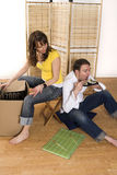 Happy couple in new place Royalty Free Stock Photography