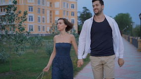 Happy couple newlyweds fun stroll along the promenade near his new home. stock video footage