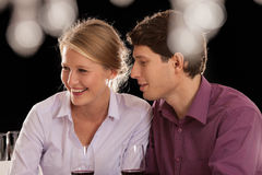 Happy couple on night out. A young couple having a nice night out with friends Stock Image