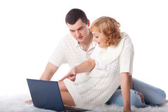 Happy couple with notebook Royalty Free Stock Images