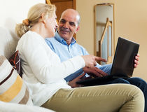 Happy couple with notebook Royalty Free Stock Image