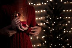 Happy couple opening Christmas gifts with gold magic lights stock image