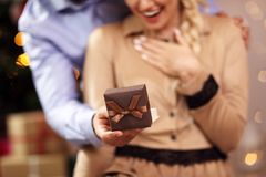 Happy Couple Opening Christmas Present Stock Image