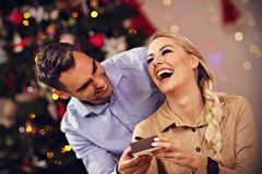 Happy Couple Opening Christmas Present Royalty Free Stock Photos