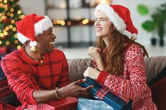 Free Happy Couple Opening Presents On Christmas Morning Stock Photos - 132082633
