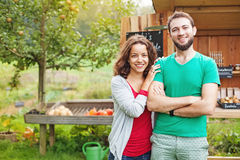 Happy couple at organic food market stock image