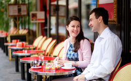 Happy couple in an outdoor cafe Stock Image