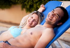 Happy Couple Outdoor Pool Stock Photo