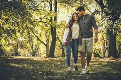 Happy couple outdoor. Walking nature. Moving activity stock photos