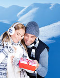 Happy couple outdoor at winter mountains Royalty Free Stock Photos