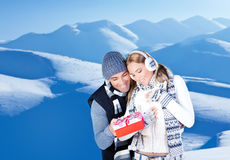 Happy couple outdoor at winter mountains Royalty Free Stock Photography