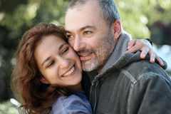 Happy couple outdoors. Laughing couple outdoors Stock Photography