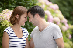 Happy couple outdoors flirting Royalty Free Stock Images
