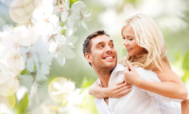 Happy couple over cherry blossoms background Stock Photo