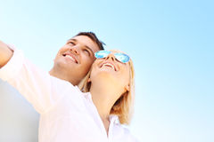 Happy couple over sky Royalty Free Stock Image
