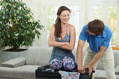 Happy couple packing Stock Image