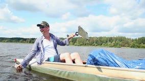 Happy couple paddling kayak, having fun. Home video, vacation. Stock footage stock video