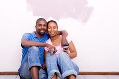 Happy couple painting home Stock Images