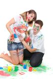 Happy couple painting over white. Young happy couple painting over white Stock Photography