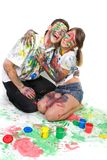 Happy couple painting over white Stock Photography