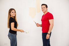 Happy couple painting a room Royalty Free Stock Photo