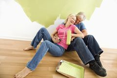 Happy couple with painting supplies Stock Photography