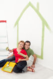 Happy couple painting in their home Stock Image