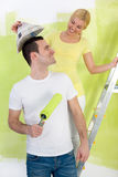 Happy  couple painting their home Royalty Free Stock Photo