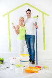 Happy couple painting their new home Stock Image