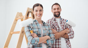 Happy couple painting their new home Stock Photography