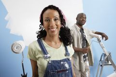 Happy Couple Painting Their New House Royalty Free Stock Photography