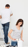 Happy couple painting together a room Stock Photography