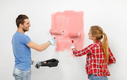 Happy couple painting wall at home royalty free stock photo