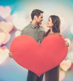 Happy couple with paper heart Royalty Free Stock Image
