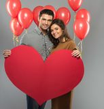 Happy couple with paper heart Royalty Free Stock Photo