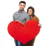 Happy couple with paper heart Stock Image