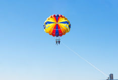Happy couple Parasailing in Dominicana beach in summer. Couple under parachute hanging mid air. Having fun. Tropical Paradise. Pos Stock Photos