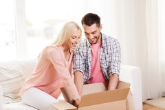 Happy couple with parcel box at home Royalty Free Stock Image