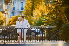 Happy couple in Paris on a fall day. Tourists enjoying their vacation in France. Romantic date or traveling couple concept stock photos