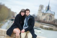 Couple in Paris on the Seine embankment Stock Photos